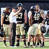 Coach Clawson talks to captains pregame