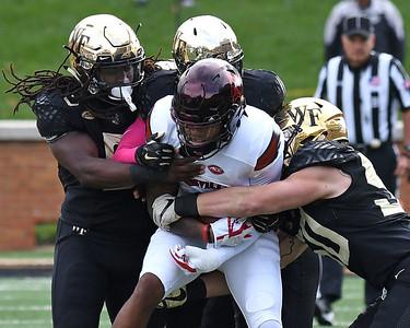 Deacon defense surrounds Lville receiver 02