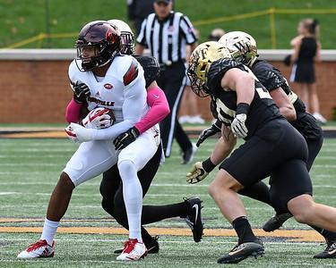 Deacon defense surrounds Lville receiver