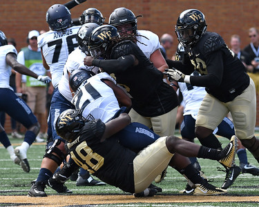 Willie Yarbary and Jaboree Williams tackle L Hunt