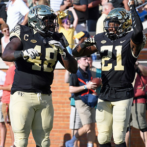 Essang Bassey celebrates TD with Willie Yarbary