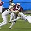 Jesse Bates and Demetrius Kemp tackle C Buckley