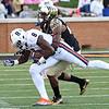 Thomas Brown tackles K Johnson