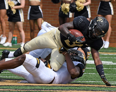 Greg Dortch tackled after catch & run 02