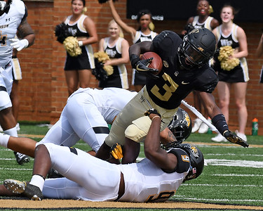 Greg Dortch tackled after catch & run