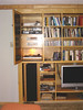 THE COMPLETE INSTALLATION.  FROM TOP TO BOTTOM:- HDDVR, SONY DVD PLAYER, QUAD FM 3 TUNER, QUAD 33 PREAMP, THORENS/SME/DECCA TURNTABLE, CUSTOM THREE WAY QB 4 REFLEX SPEAKERS, QUAD 405 2 POWER AMP AND SONY BRAVIA LCD HD TV.