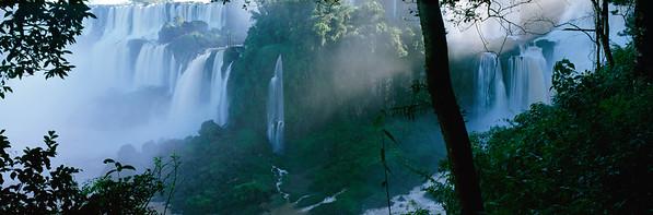 Iguaçu National Park, Argentina, Brazil --- Cascades of Iguacu Falls surrounded by tropical rainforest, Iguacu Falls National Park, Brazil --- Image by © Thomas Mangelsen/Minden Pictures/Corbis