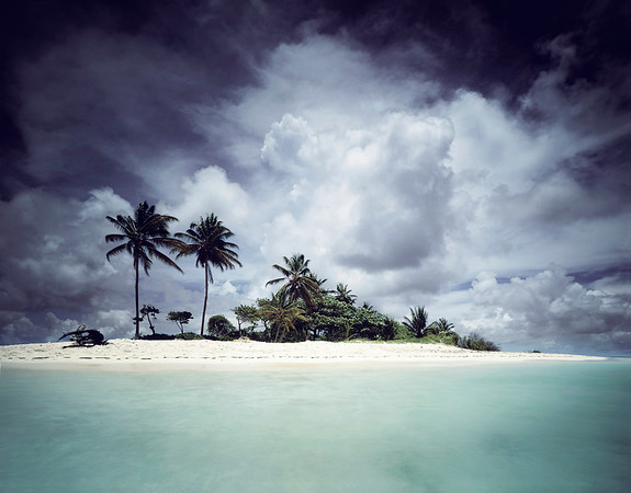 A tiny deserted tropical island in the west indies with coral sea and tropical cloud sky. --- Image by © Darran Rees/Corbis