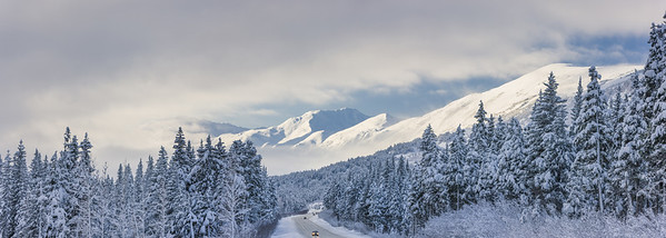 Clouds clearing over Seward Highway from the Kenai Mountains above Turnagain Pass after a winter snow storm, fresh snow in the trees, early morning sun, Turnagain Pass, Chugach National Forest, Southcentral Alaska, USA. --- Image by © Kevin Smith/Design Pics/Corbis