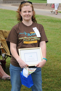 Captain Annie holding one of our awards