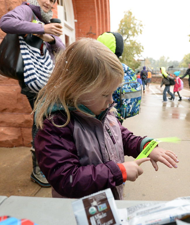 . BOULDER, CO - October 10, 2018:  Students from University  Hill Elementary in Boulder gather around the prize tents after walking or riding to school. Over 40 schools in the Boulder Valley School District (BVSD) joined in   Walk or Ride to School Day events at their schools. Students will be encouraged to walk or bike to school to build community, promote health, contribute to a cleaner planet and champion safer routes to school on October 10, 2018. (Photo by Cliff Grassmick/Staff Photographer))