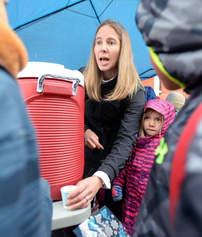 . BOULDER, CO - October 10, 2018: Meghan Sloan (cq) gives out hot apple cider to arriving students.  Students from University  Hill Elementary in Boulder gather around the prize tents after walking or riding to school. Over 40 schools in the Boulder Valley School District (BVSD) joined in   Walk or Ride to School Day events at their schools. Students will be encouraged to walk or bike to school to build community, promote health, contribute to a cleaner planet and champion safer routes to school on October 10, 2018. (Photo by Cliff Grassmick/Staff Photographer))