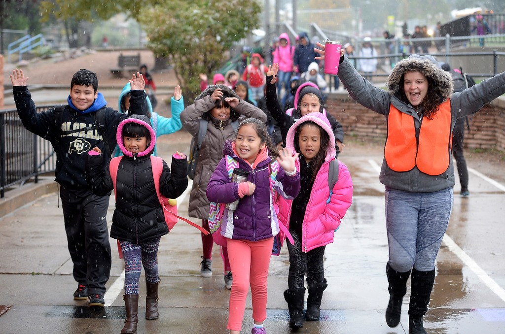 . BOULDER, CO - October 10, 2018:  Crossing guard, Alexandra Johnson, (cq) right, leads a large group of kids to University Hill Elementary in Boulder on Wednesday.  Over 40 schools in the Boulder Valley School District (BVSD) joined in   Walk or Ride to School Day events at their schools. Students will be encouraged to walk or bike to school to build community, promote health, contribute to a cleaner planet and champion safer routes to school on October 10, 2018. (Photo by Cliff Grassmick/Staff Photographer))