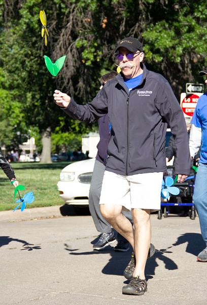 Manhattan community member participates in the Walk to end Alzheimer's on Sept. 22. Participants walk a lap around City Park in support of their loved ones that have been diagnosed. (Jessica Cude | Collegian Media Group)