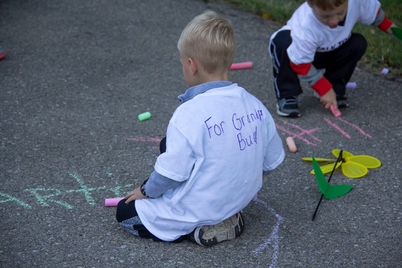Playing in the kids area before the Walk to End Alzheimer's, two boys draw with chalk on Sept. 22 at City Park. Many families support their loved ones together by participating in the walk. (Jessica Cude | Collegian Media Group)