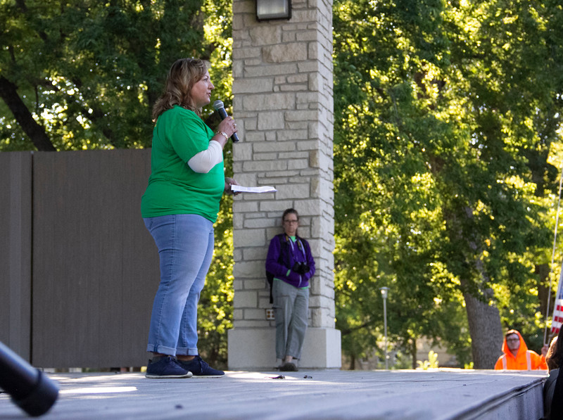 A representative from Edward Jones talks in front of the crowd at the ceremony before the Walk to end Alzheimer's. Over 50 Edward Jones employees participated in the walk.  (Jessica Cude | Collegian Media Group)