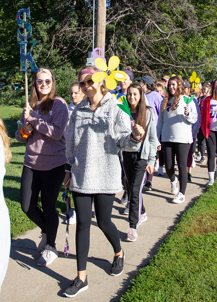 Carrying a yellow flower to support someone that is a currently diagnosed with Alzheimer's, sorority members of Sigma Kappa walk on Sept. 22 at the Walk to end Alzheimer's. (Jessica Cude | Collegian Media Group)
