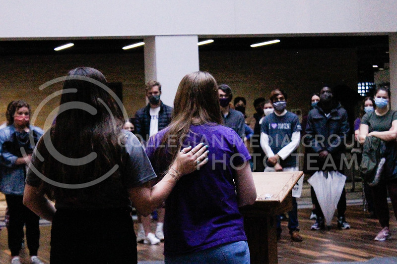 During the annual Walk Against Sexual Violence rally, freshman Emily Gregg (right) shares her story of experiencing sexual battery during her first semester at K-State while K-State alumnae Paige Eichkorn, a fellow survivor of sexual assault, comforts her. (Kaylie McLaughlin | Collegian Media Group)