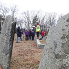 Once hiking is done, Hike Beautiful Billerica guide Marlies Henderson gives a history lesson -- and a challenge: to find the gravestone of Samuel Manning. Photo by Mary Leach