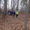 Outdoor enthusiast Marlies Henderson leads Hike Beautiful Billerica down the wooded path. Photo by Mary Leach
