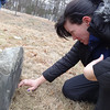 Natalie Kelsey carefully clears the grass away from the gravestone of Samuel Manning. Photo by Mary Leach