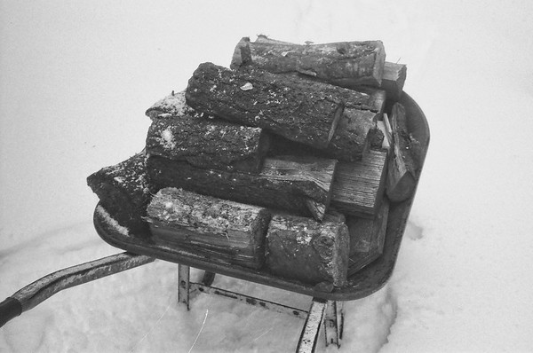 One wheelbarrow of wood gives 24 hours of heat.