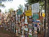 """That single sign has grown in to a """"forest"""" of 54,000 signs from visitors that have come from all over the world."""
