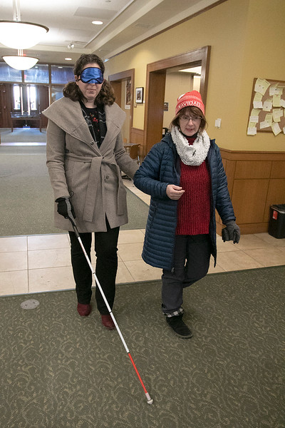 Visions consulting L3C held a teaching the sighted to be blind event in Leominster on Friday afternoon, Dec. 20, 2019 with the Lions Club. Participating in the event was Mayor Dean Mazzarella and State Representative Natalie Higgins. They were lead around the downtown to see how tough it was and to find out what could be changed to help those that are sight challenged. Higgins, while blindfolded, learns to use a walking cane while being helped by Colleen Oncay the District Gov. of the MA 33a Lions Club while still in the Leominster Public Library. SENTINEL & ENTERPRISE/JOHN LOVE