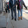 Visions consulting L3C held a teaching the sighted to be blind event in Leominster on Friday afternoon, Dec. 20, 2019 with the Lions Club. Participating in the event was Mayor Dean Mazzarella and State Representative Natalie Higgins. They were lead around the downtown to see how tough it was and to find out what could be changed to help those that are sight challenged. Mazzarella, blindfolded, makes his way around downtown with the help of volunteer Rosy Castro RN from Worcester. Just behind them is Higgins with Colleen Oncay the district gov. of the MA 33a Lions Club. SENTINEL & ENTERPRISE/JOHN LOVE