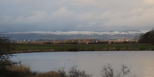 The snowy Campsies beyond Waulkmill Glen Reservoir