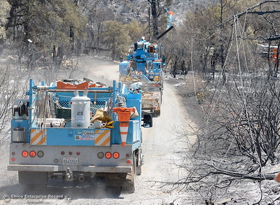 With downed power lines still hanging, PG&E crews arrive to an area near Viewcrest Drive after the Wall Fire in Oroville, Calif. Mon. July 10, 2017. (Bill Husa -- Enterprise-Record)