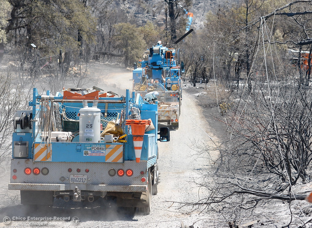 . With downed power lines still hanging, PG&E crews arrive to an area near Viewcrest Drive after the Wall Fire in Oroville, Calif. Mon. July 10, 2017. (Bill Husa -- Enterprise-Record)