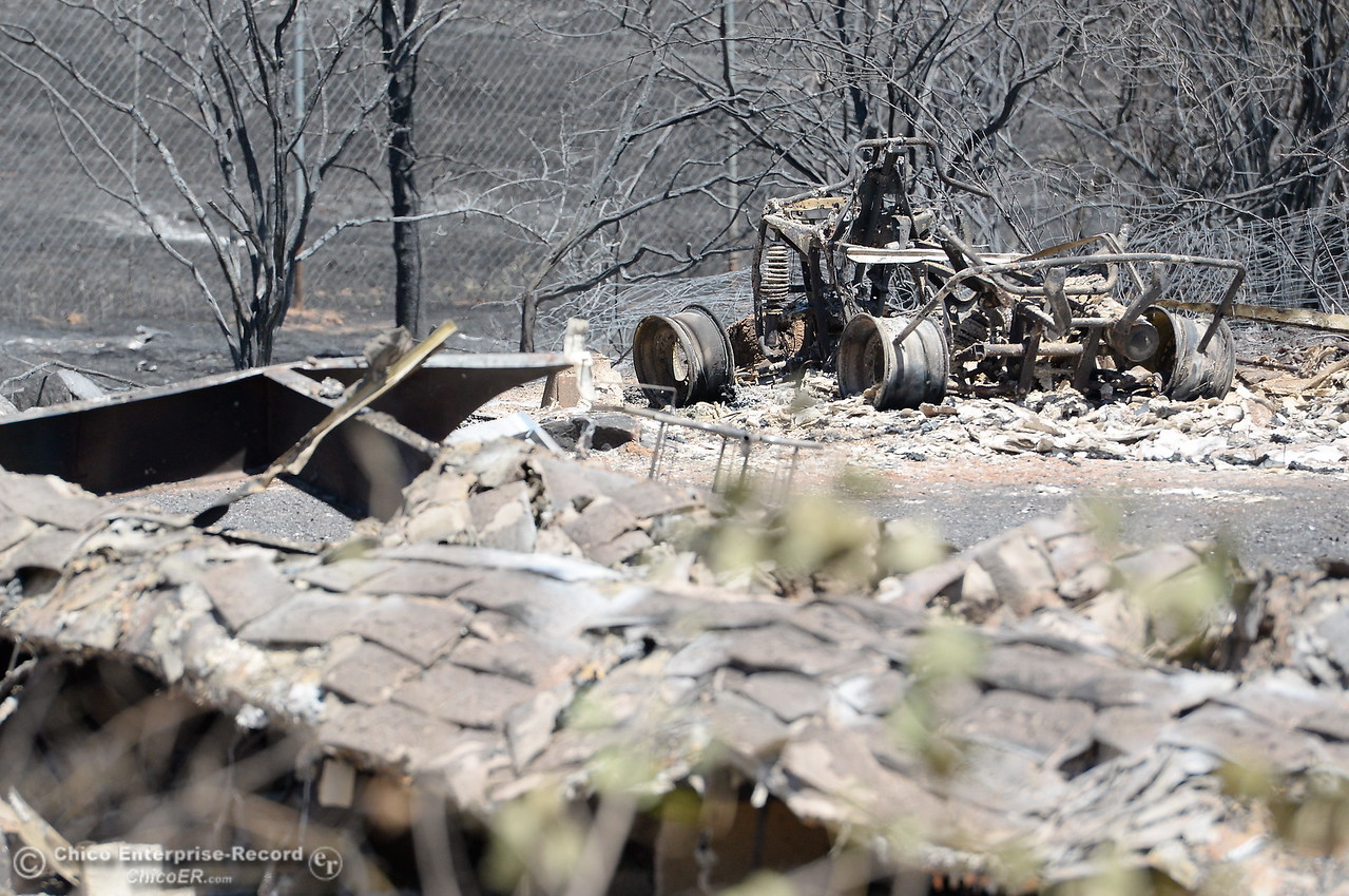 The charred remains of a vehicle is seen beside a structure that was also lost at Bardolino Lane and Viewcrest Drive after the Wall Fire near Oroville, Calif. Mon. July 10, 2017. (Bill Husa -- Enterprise-Record)