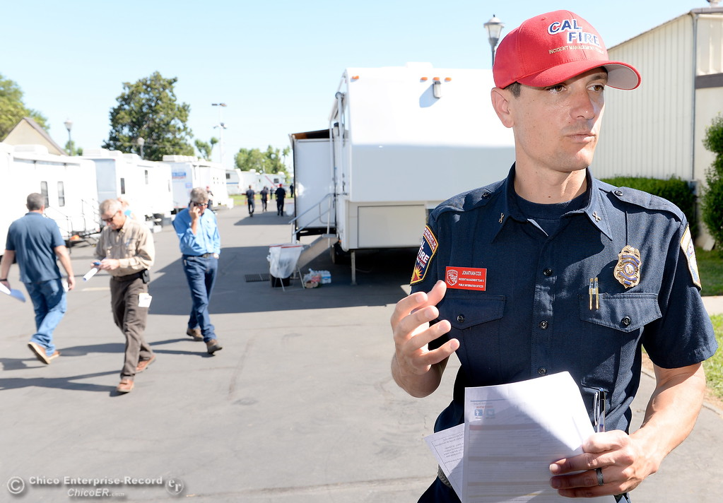 . CAL FIRE PIO Jonathon Cox talks briefly with members of the media at the Silver Dollar Fair Incident Command area for the Wall Fire near Oroville, Calif. Mon. July 10, 2017. (Bill Husa -- Enterprise-Record)