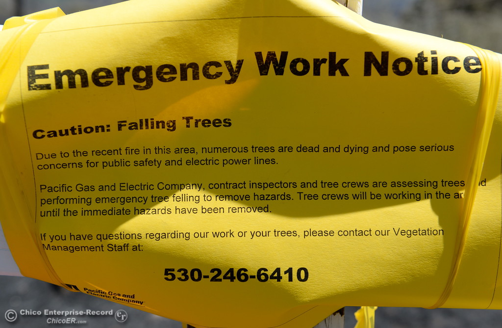 . An emergency work notice posted by PG&E is seen on a post at Bardolino Land and Viewcrest Drive after the Wall Fire near Oroville, Calif. Mon. July 10, 2017. (Bill Husa -- Enterprise-Record)