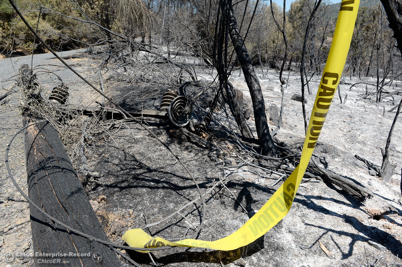 The remnants of a charred power pole are seen among the 5,600 acres of charred brush and trees following the Wall Fire near Oroville, Calif. Mon. July 10, 2017. (Bill Husa -- Enterprise-Record)