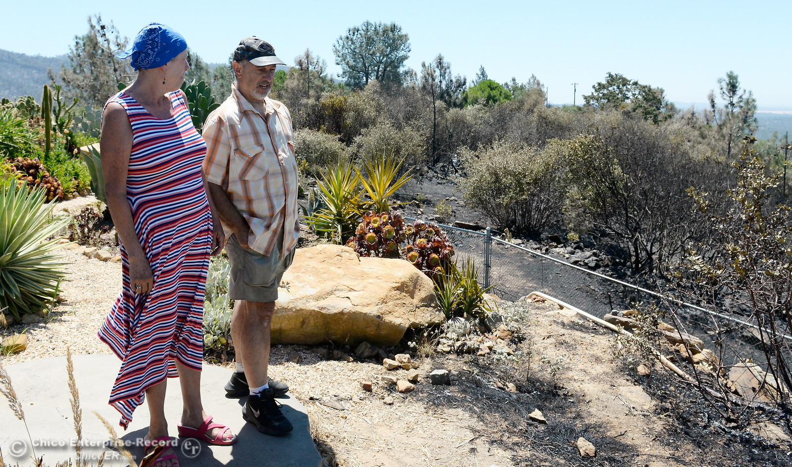 Thankfull to still have their home, Cathy and Don Prestella smile after the Wall Fire nearly claimed their Viewcrest Drive home in Oroville, Calif. Mon. July 10, 2017. (Bill Husa -- Enterprise-Record)