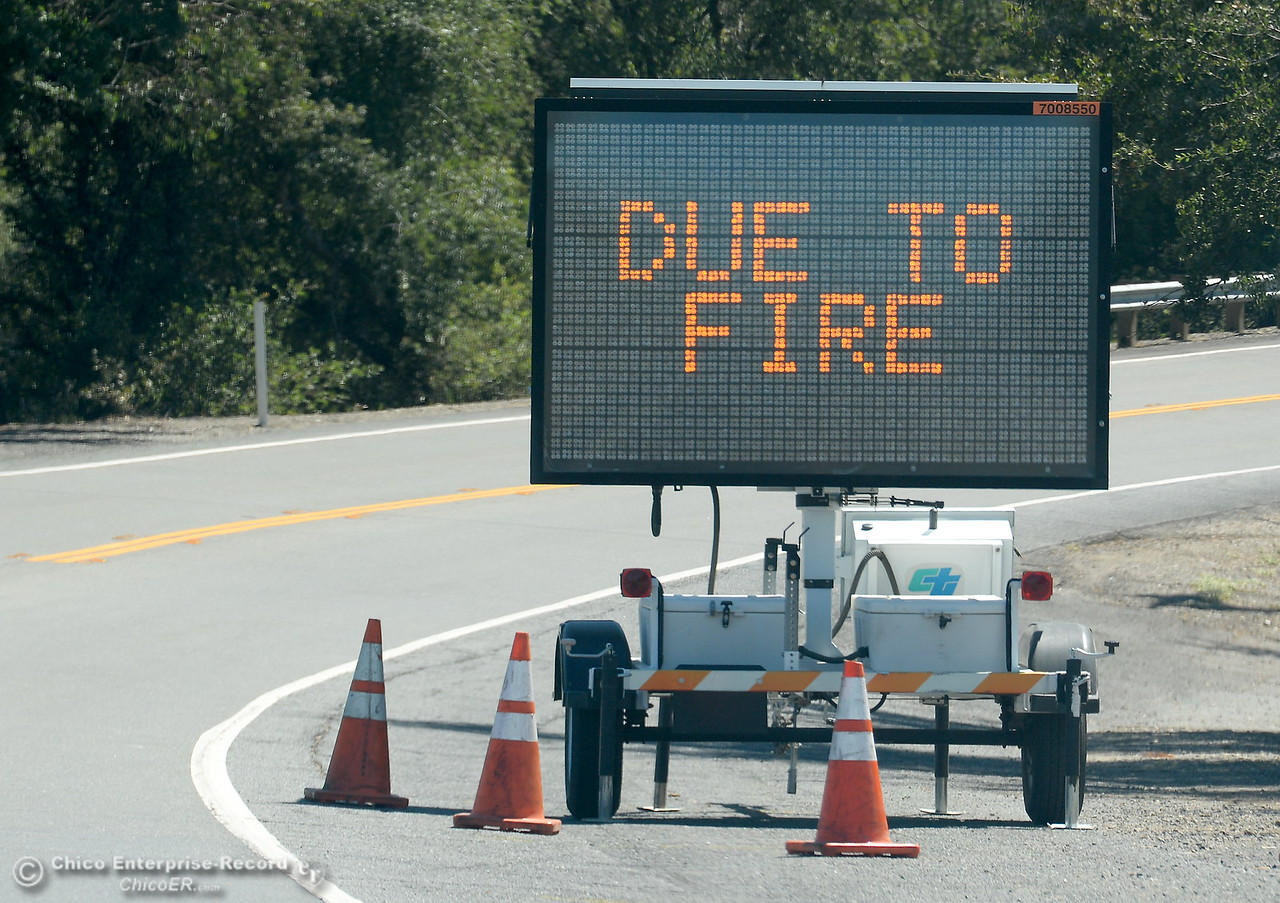 A sign tells driver Hwy. 162 is closed due to fire during the Wall Fire near Oroville, Calif. Mon. July 10, 2017. (Bill Husa -- Enterprise-Record)