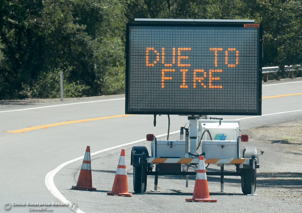 . A sign tells driver Hwy. 162 is closed due to fire during the Wall Fire near Oroville, Calif. Mon. July 10, 2017. (Bill Husa -- Enterprise-Record)