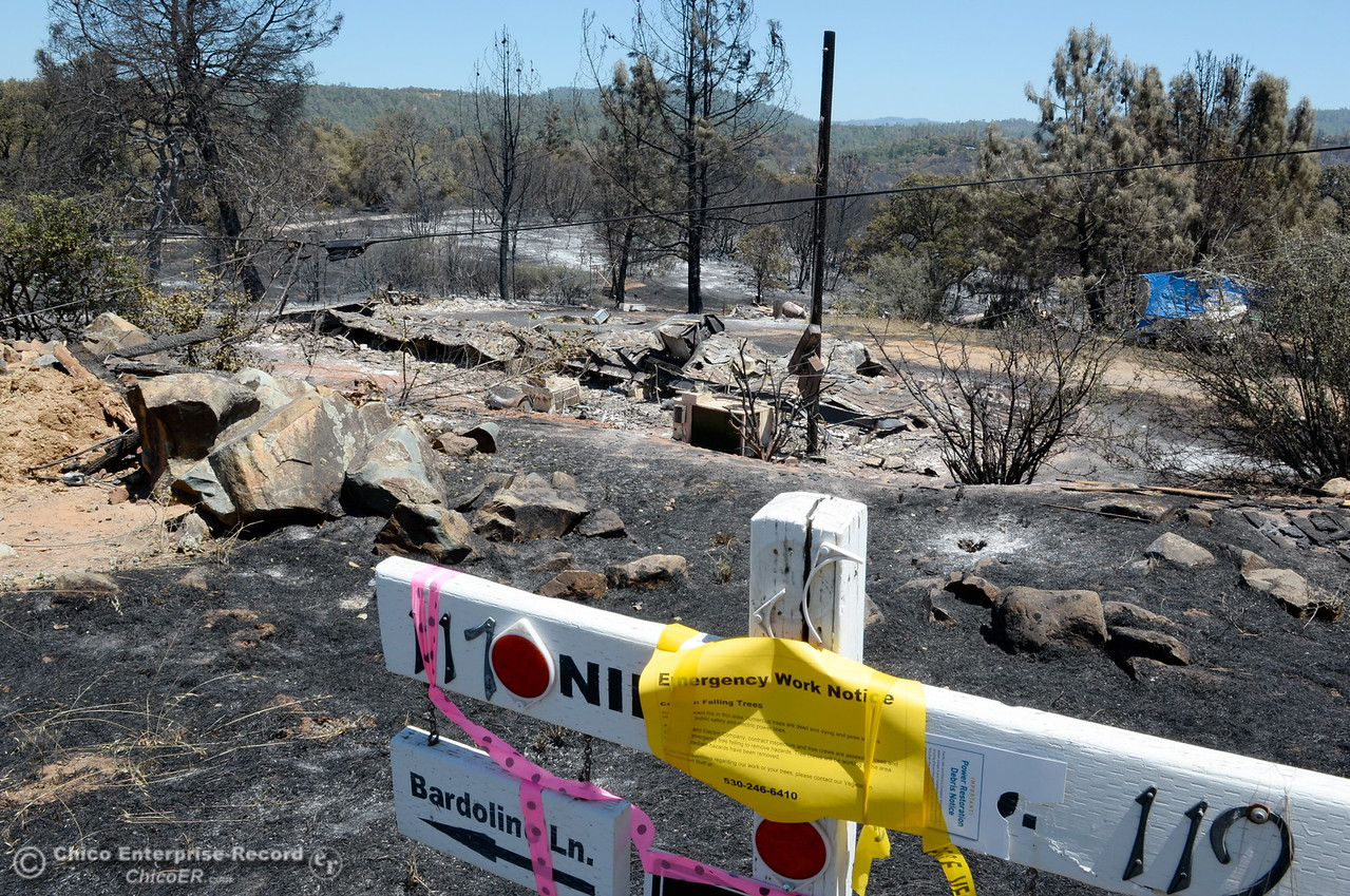 An emergency work notice posted by PG&E is seen on a post at Bardolino Lane and Viewcrest Drive after the Wall Fire destroyed a structure near the corner in Oroville, Calif. Mon. July 10, 2017. (Bill Husa -- Enterprise-Record)