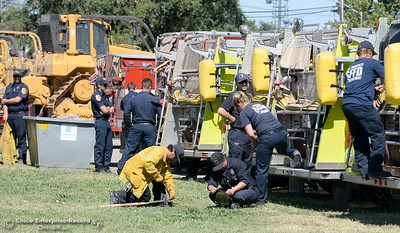 Firefighters are seen at the Silver Dollar Fairgrounds Incident Base area for the Wall Fire near Oroville, Calif. Mon. July 10, 2017. (Bill Husa -- Enterprise-Record)