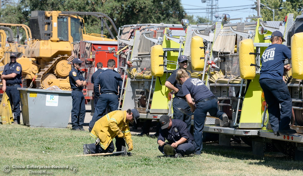 . Firefighters are seen at the Silver Dollar Fairgrounds Incident Base area for the Wall Fire near Oroville, Calif. Mon. July 10, 2017. (Bill Husa -- Enterprise-Record)