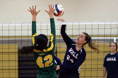 #24, Kristina Hotaling of the Wall High School Varsity Volleyball Team returns the ball to the Red Bank Catholic High School side of the net during their match played at Wall High School, Wall, NJ on 09/09/2019. (STEVE WEXLER/THE COAST STAR).