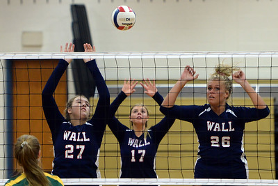 #27, Stephanie Ahern, #17, Katie Fletcher, and #26, Megan Oakley of the Wall High School Girl's Varsity Volleyball Team react to a Red Bank Caholic High School serve during their match played at Wall Township High School, Wall, NJ on 09/09/2019. (STEVE WEXLER/THE COAST STAR).