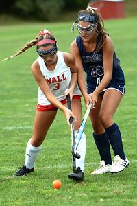 #3, Rebecca Phelps of the Wall High School Girl's Varsity Field Hockey Team moves the ball around #33, Ali Presbrey of Manasquan High School, in their game played at Wall High School field, in Wall Township, NJ on 09/05/2019. (STEVE WEXLER/THE COAST STAR)