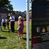 "Banners of various Fitchburg veretans are on display during a ceremony on Thursday at Crocker Field in Fitchburg commemorating ""The Wall That Heals.""  SENTINEL & ENTERPRISE JEFF PORTER"