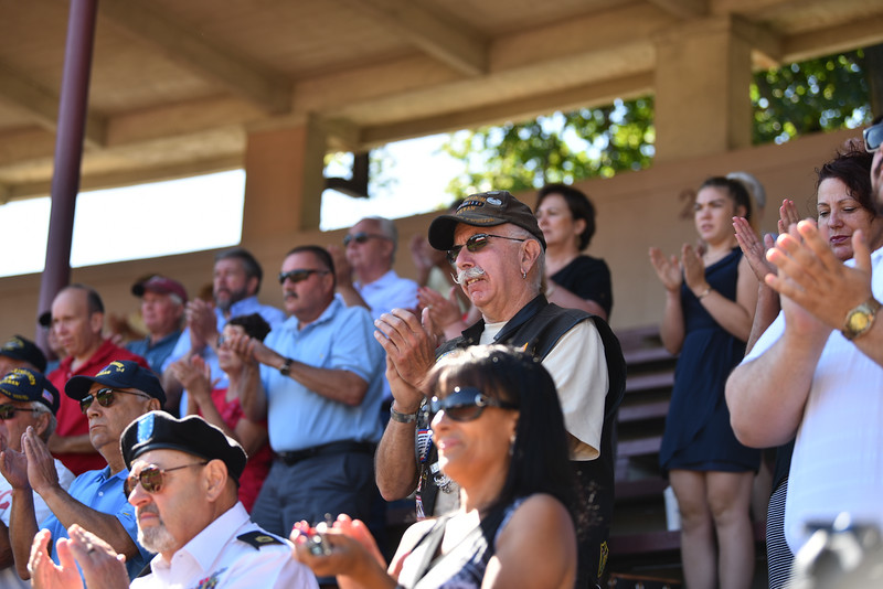 "Fitchburg Locals both veterans and civilians listen to speakers during a ceremony on Thursday at Crocker Field in Fitchburg commemorating ""The Wall That Heals.""  SENTINEL & ENTERPRISE JEFF PORTER"