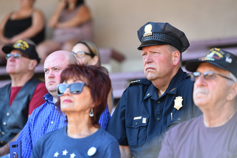 """Fitchburg Cheif of Police Ernest Martineau listens to speakers during a ceremony on Thursday at Crocker Field in Fitchburg commemorating """"The Wall That Heals.""""  SENTINEL & ENTERPRISE JEFF PORTER"""