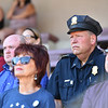 "Fitchburg Cheif of Police Ernest Martineau listens to speakers during a ceremony on Thursday at Crocker Field in Fitchburg commemorating ""The Wall That Heals.""  SENTINEL & ENTERPRISE JEFF PORTER"