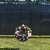 "A wreathe is in place in front of ""The Wall That Heals"" during a ceremony on Thursday at Crocker Field in Fitchburg commemorating the wall.  SENTINEL & ENTERPRISE JEFF PORTER"